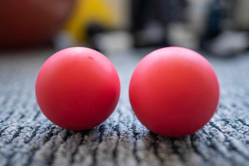 two lacrosse physical therapy balls