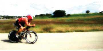 man on triathlon bike